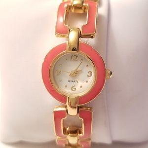 Quartz gold metal and orange band watch.